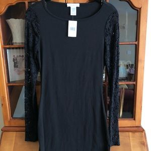 NWT. Body con black dress lace long sleeves.